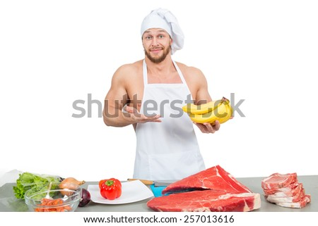 chef in a white apron holding bananas - stock photo