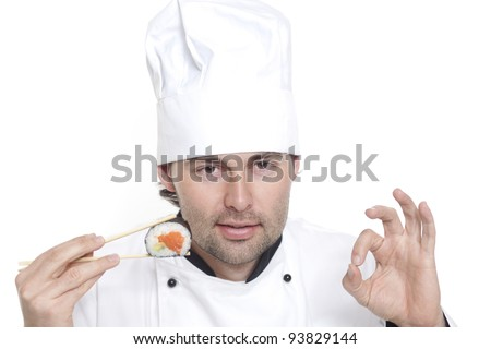 Chef in Chef's Hat recommends sushi - stock photo
