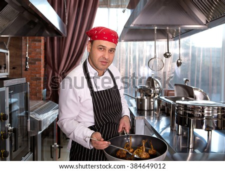 chef in the kitchen at the restaurant for cooking corporate cuisine