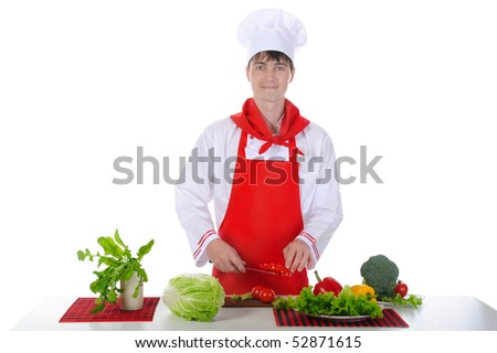 Chef in uniform cut tomatoes. Isolated on white background - stock photo