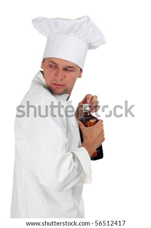 chef in white uniform and hat with brown bottle - stock photo