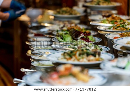 Chef arranging food on buffet table stock photo 771377812 shutterstock chef is arranging the food on buffet table watchthetrailerfo