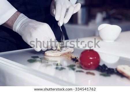 Chef is cooking a gourmet dish, toned image - stock photo