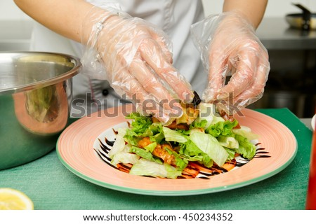 Chef is cooking appetizer at commercial kitchen - stock photo