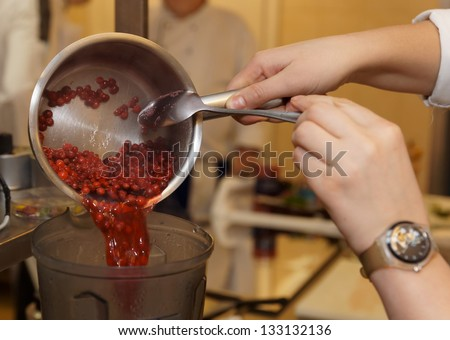 Chef is cooking barry sauce in blender at restaurant kitchen - stock photo