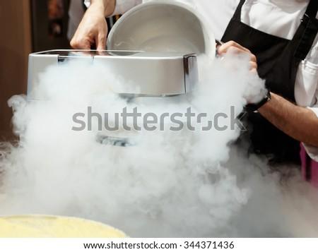 Chef is making ice cream with liquid nitrogen - stock photo