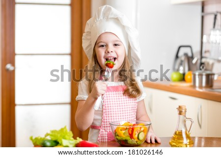 Chef kid tasting healthy food - stock photo