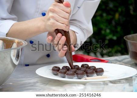 Chef making chocolate - stock photo