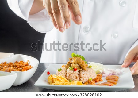 chef making thai cuisine, Rice Mixed with Shrimp paste in restaurant