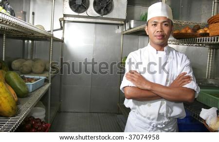 chef posing in refrigerator - stock photo