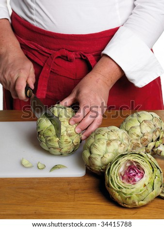 Chef preparing artichoke - stock photo