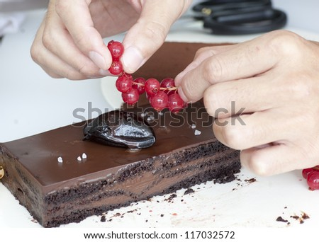 chef preparing delicious chocolate cake  at kitchen