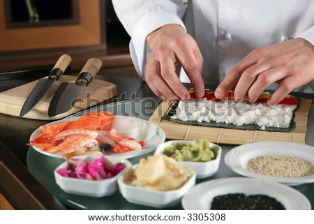 Chef Preparing Sushi - stock photo