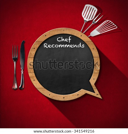 Chef Recommends - Blackboard Speech Bubble Shaped / Blackboard in the shape of speech bubble with text Chef Recommends with kitchen utensils on a red velvet background - stock photo