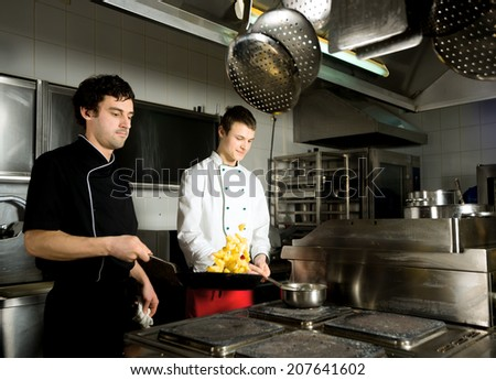 chef restaurant keeps food for hotel guests/chef restaurant - stock photo