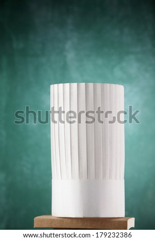 chef,s cap in front of  the chalkboard - stock photo