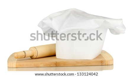 Chef's hat with battledore isolated on white - stock photo