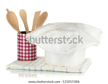 Chef's hat with kitchen towel and spoon isolated on white - stock photo