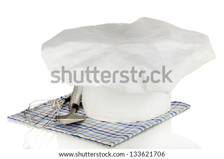 Chef's hat with kitchenware isolated on white - stock photo