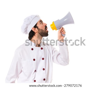 Chef shouting by megaphone - stock photo
