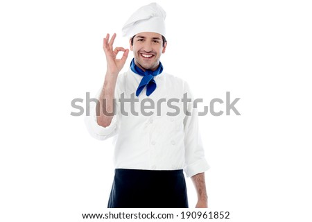 Chef showing hand sign for perfection and excellence