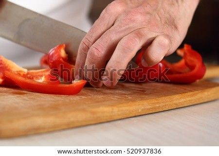 Chef slicing red bell pepper. Making Chicken and Egg Galette Series.
