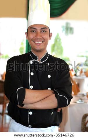 chef standing at restaurant - stock photo