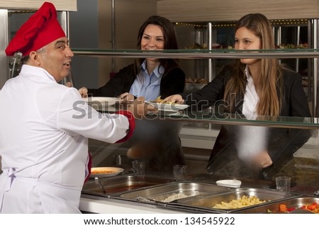 chef standing behind full lunch service station