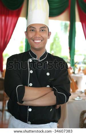 chef standing in restaurant - stock photo