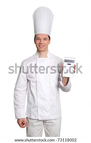 Chef standing on white background with calculator - stock photo
