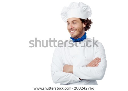 Chef standing with arms crossed, looking away - stock photo