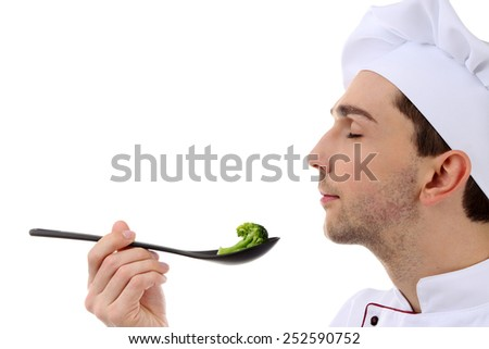 Chef tasting broccoli isolated on white - stock photo