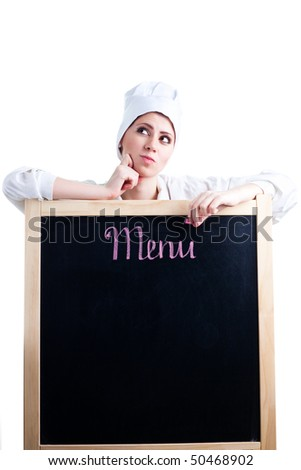 Chef thinking about menu to write on blackboard - stock photo