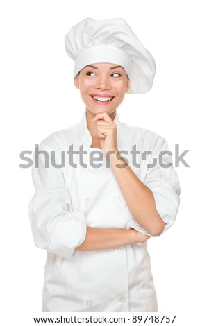 Chef thinking looking smiling and happy to the side. Woman chef, cook or baker in chef uniform and hat. Young asian female isolated on white background. - stock photo