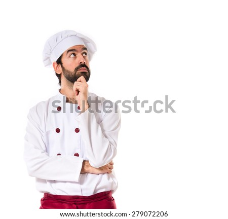 Chef thinking over white background - stock photo