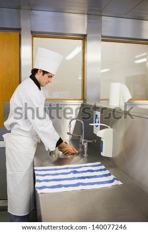Chef washing hands in the restaurant - stock photo