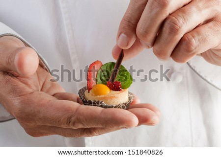 chef with dessert in hand
