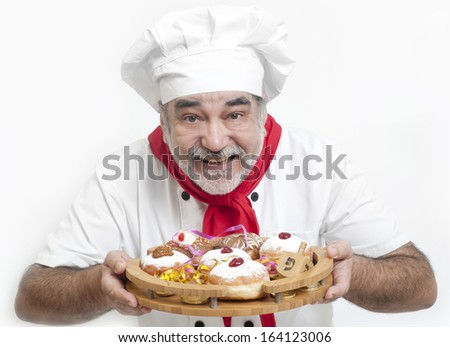 chef with fresh hanukkah donuts