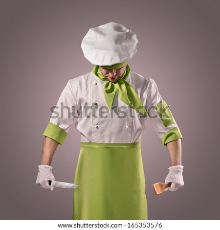 chef with knife and kitchen spatula - stock photo