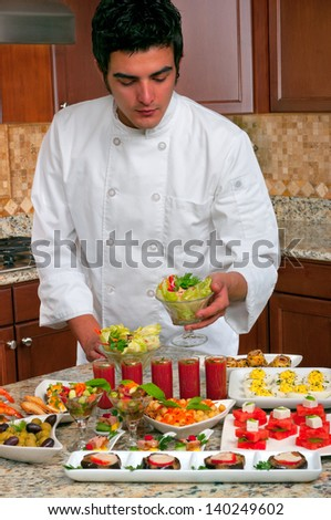 Chef with many different appetizers - stock photo