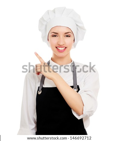 Chef woman in white uniform and hat pointing up, white background - stock photo