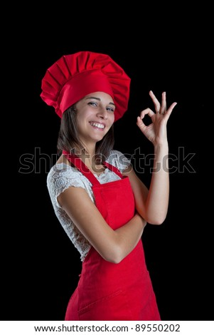 Chef woman making tip with her hand to symbolize deliciousness - stock photo