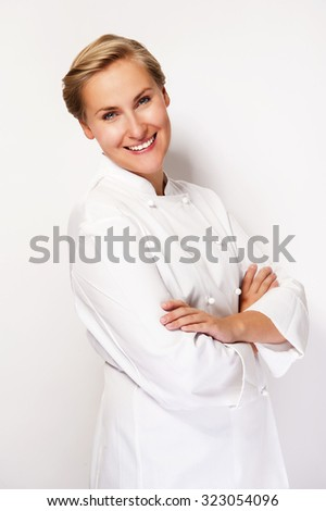 Chef woman over white background with crossed arms smiling with chef outfit.