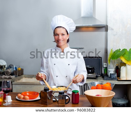 Chef woman portrait with white uniform in the kitchen