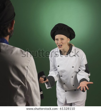 cheff scoulding her assitance - stock photo