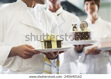 Chefs Holding Desserts - stock photo