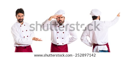 Chefs showing and presenting something - stock photo