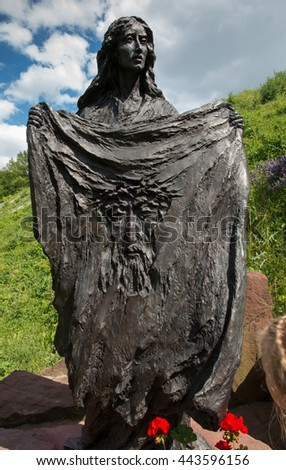 Chelm, Poland - June 12, 2016: Saint Veronica with the reflection of the face of Jesus on a sling. Station cross road in the park at the Basilica in Chelm, Poland - stock photo