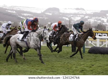 CHELTENHAM, GLOUCS-JANUARY 26: Jockeys jostle for position in the third race at Festival Trials Day, Cheltenham Racecourse, Cheltenham UK on Jan 26, 2013. - stock photo