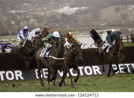 CHELTENHAM, GLOUCS-JANUARY 26: Jockeys take their horses over jumps in the third race at Festival Trials Day, Cheltenham Racecourse, Cheltenham UK on Jan 26, 2013.